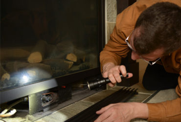 Inspecting a gas fire place