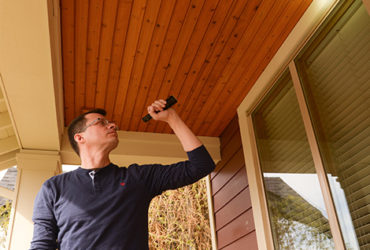 Inspecting the ceiling of a front porch